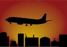 Vliegtuig en stad Royalty-vrije Stock Foto