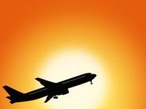 Vliegtuig en zonsondergang Stock Foto's