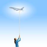 Vliegtuig in hemel Royalty-vrije Stock Afbeeldingen