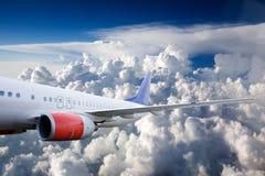 Vliegtuig in Hemel Stock Foto's