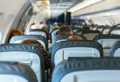 Vliegtuig met passagiers stock afbeelding