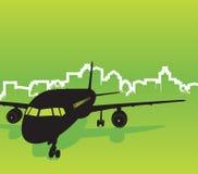 Vliegtuig met stadsachtergrond Stock Foto
