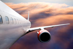 Vliegtuig tijdens de vlucht Stock Foto's