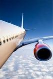 Vliegtuig tijdens de vlucht Stock Foto