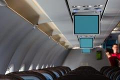 Vliegtuigcabine met de schermen Royalty-vrije Stock Foto's