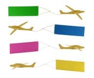 Vliegtuigen die gekleurde banners trekken Royalty-vrije Stock Foto