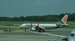 Vliegtuigen die in Singapore Changi dokken stock afbeeldingen