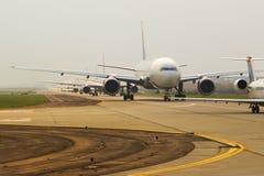 Vliegtuigen in Lijn Stock Foto