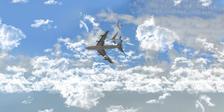 Vliegtuigen tussen witte wolken Royalty-vrije Stock Afbeeldingen