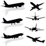 Vliegtuigsilhouet in zwarte vector Stock Afbeeldingen