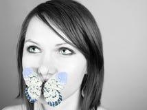 Vlinder op lippen Royalty-vrije Stock Afbeeldingen