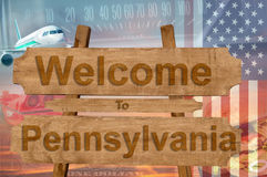 Välkomnande till det Pensylvania tillståndet i USA tecknet på trä, travelltema Arkivfoto