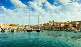 Vlletta pier with yachts and cityscape, view from water Royalty Free Stock Photo