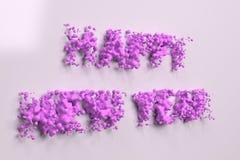 Vloeibare violette Gelukkige Nieuwjaarwoorden met dalingen op witte achtergrond Stock Foto