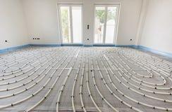 Vloerverwarming in bouw stock afbeeldingen