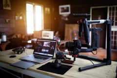 Vlogger equipment for Filming a movie or a video blog. Drone Steadicam Camera Stabilizer and laptop royalty free stock image