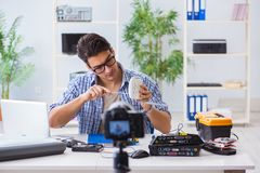 The vlogger recording computer repair on camera for vlog blog Stock Photos