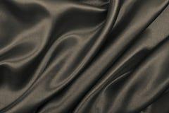Vlotte elegante bruine zijde of satijntextuur als samenvatting backgroun stock foto