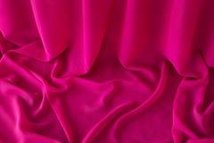 Vlotte elegante roze chiffon of satijntextuur als achtergrond Stock Afbeeldingen