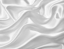 Vlotte elegante witte zijde of satijntextuur als huwelijksachtergrond Royalty-vrije Stock Afbeeldingen