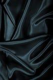 Vlotte elegante zwarte zijde of satijntextuur als achtergrond Royalty-vrije Stock Afbeelding