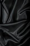 Vlotte elegante zwarte zijde of satijntextuur als achtergrond Royalty-vrije Stock Afbeeldingen