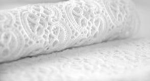 Vlotte witte kantachtergrond Stock Afbeelding