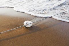 Vlotter en kabel stock foto