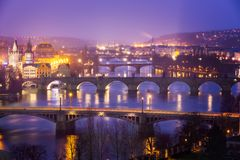 Vltava (Moldau) River at Prague with Charles Bridge at dusk Stock Photos
