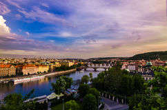 Vltava river and bridges in Prague at sunset Stock Photos