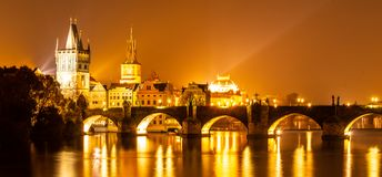 Vltava River and Charles Bridge with Old Town Bridge Tower by night, Prague, Czechia. UNESCO World Heritage Site royalty free stock photos