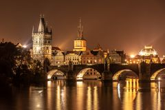 Vltava River and Charles Bridge with Old Town Bridge Tower by night, Prague, Czechia. UNESCO World Heritage Site stock photo