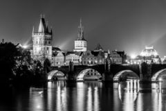 Vltava River and Charles Bridge with Old Town Bridge Tower by night, Prague, Czechia. UNESCO World Heritage Site royalty free stock photography