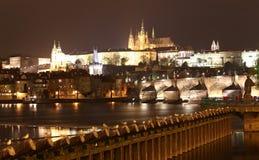 Vltava river, Charles Bridge (Stone Bridge, Prague Bridge)  and St. Vitus Cathedral at night. Prague. Royalty Free Stock Image