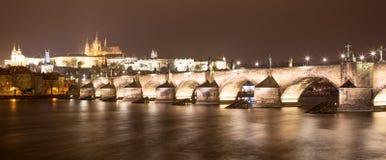 Vltava river, Charles Bridge (Stone Bridge, Prague Bridge)  and St. Vitus Cathedral at night. Prague Stock Photos