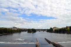 Vltava River in Prague summer cloudy day. Czech Republic. View from the Bridge Stock Images