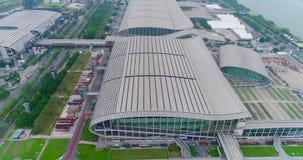 Vlucht dichtbij de Pazhou-Complexe Tentoonstelling De internationale Markt van het tentoonstellingskanton Lucht Mening Complexe P stock videobeelden