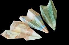 Vluchten van geld Stock Foto