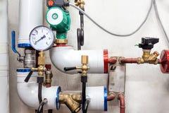 Válvulas de un sistema de calefacción Fotografía de archivo libre de regalías