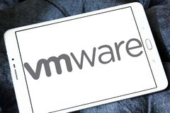 VMware computer software company logo. Logo of VMware computer software company on samsung tablet. VMware provides cloud computing and platform virtualization stock photos
