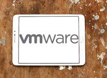 VMware computer software company logo. Logo of VMware computer software company on samsung tablet on wooden background. VMware provides cloud computing and royalty free stock image