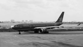 VNA airplane on runway at Tan Son Nhat airport in Saigon, Vietnam Royalty Free Stock Photo