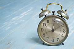 Vntage alarm clock wooden background Royalty Free Stock Images
