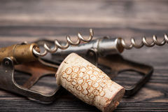 Vntage corkscrew and cork Royalty Free Stock Photo