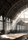 Vntage old-style architectural romantic train station. Light ray inside railway station. Royalty Free Stock Images
