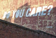 Você importa-se grafittis da parede Fotografia de Stock