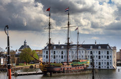 VOC Amsterdam at the museum. Beautiful VOC ship replica the Amsterdam in front of The National Maritime Museum (Scheepvaartmuseum) in Amsterdam, the Netherlands Royalty Free Stock Photography