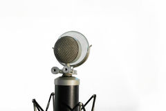 Vocal condenser microphone with wind screen isolated on white background Royalty Free Stock Photos