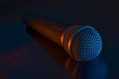 Vocal microphone. Vocal mike in a color light Royalty Free Stock Images