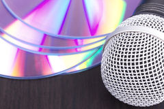 Vocal microphone and audio discs Royalty Free Stock Photos